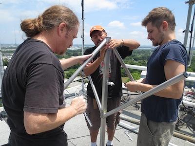 Prometheus engineers and WOHM staff assemble LPFM antenna