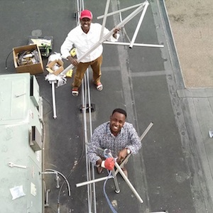 Mahamed and Abdirahman prepare the KALY antenna for installation